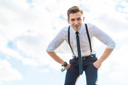 Businessman in white shirt on the roof