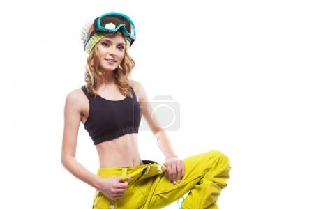 young woman in ski glasses and trousers