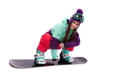 woman in purple ski rides snowboard
