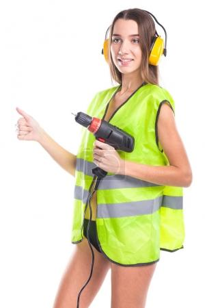 attractive young brunette woman with screwdriver