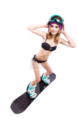 young pretty woman in bikini on snowboard