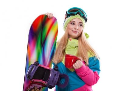 woman in ski outfit with snowboard