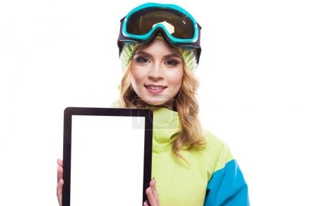 woman in ski suit with empty tablet