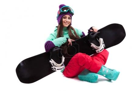 pretty woman in ski suit with snowboard