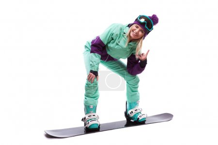 woman in ski suit rides snowboard
