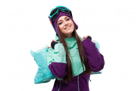 Young woman in purple ski outfit