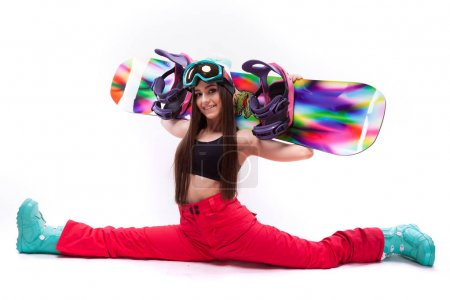 slim young woman holds snowboard