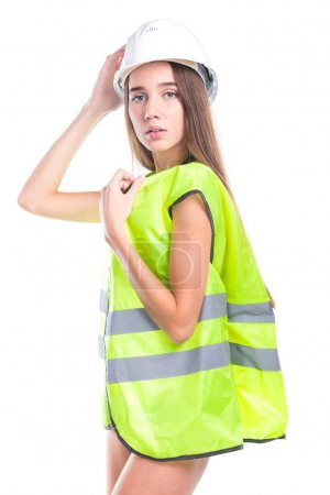 girl in yellow construction vest and helmet