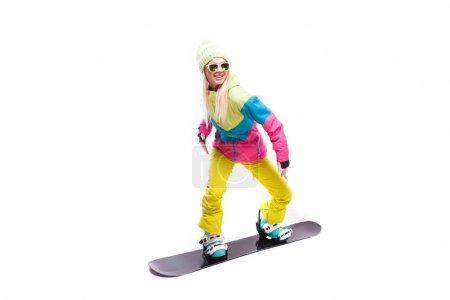 woman in ski suit with snowboard