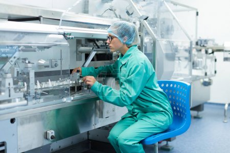 scientist is standing near machine at factory