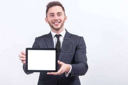 Young businessman with tablet in hands