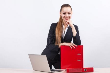 Girl manager with folders in office