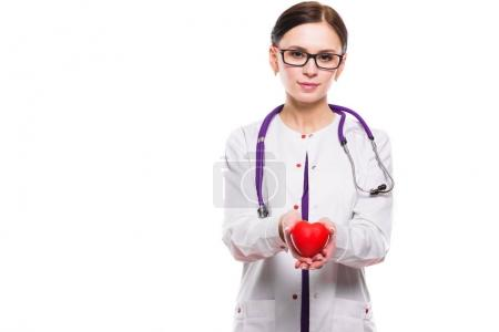 Photo for Young female doctor holding toy heart isolated on white - Royalty Free Image