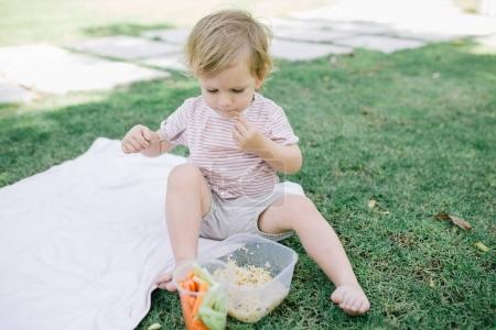baby girl eating outdoor