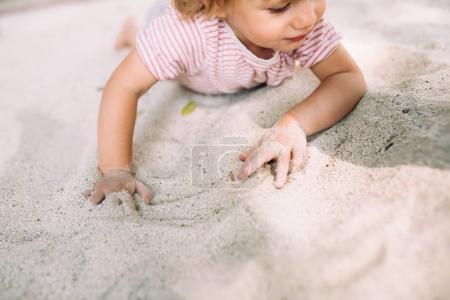 baby girl on sandy beach