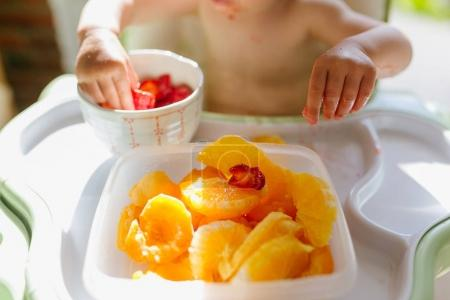 Photo for Plates with fruits on baby table, healthy eating for toddler - Royalty Free Image