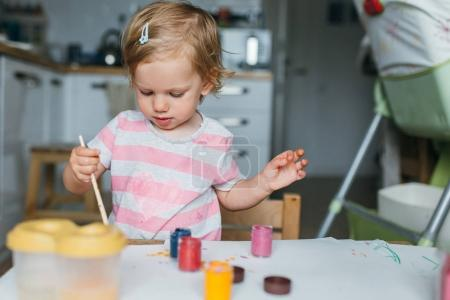 Photo for Portrait of adorable baby girl painting at home - Royalty Free Image