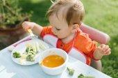 baby girl eating puree