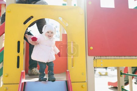 baby girl on slide