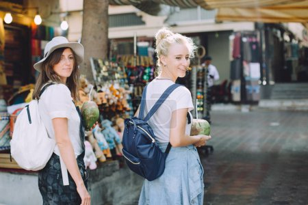 two young happy women at traditional bazaar in Dubai, UAE