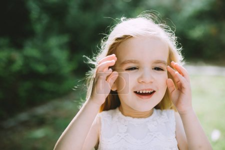 Photo for Portrait of cute little girl smiling in summer park - Royalty Free Image