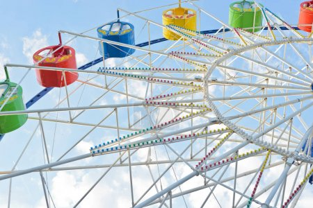 Photo for Part of white ferris wheel with colorful cabins - Royalty Free Image