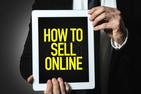 Photo for Businessman holding tablet with inscription How To Sell Online - Royalty Free Image