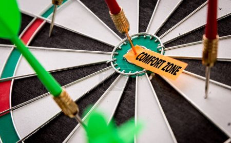 Photo for Paper attached to darts target with inscription comfort zone - Royalty Free Image