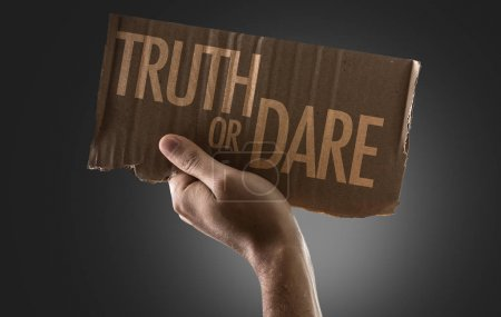 cardboard with sign truth or dare