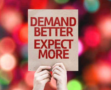 Demand Better Expect More placard with bokeh background