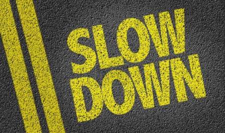 Photo for Asphalt road with yellow sign slow down - Royalty Free Image