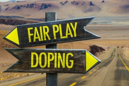 Photo pour Fair Play vs Doping flèches de signalisation en bois - image libre de droit