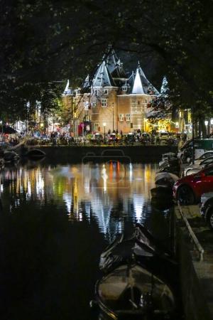 AMSTERDAM, NETHERLANDS - JANUARY CIRCA, 2017:  street at night, Amsterdam, De Waag, Historical Landmark