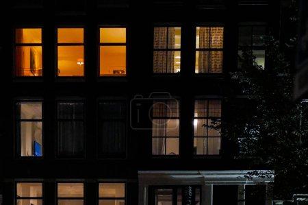 AMSTERDAM, NETHERLANDS - JANUARY CIRCA, 2017:  street at night, Amsterdam. Light in windows