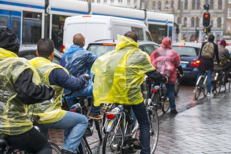 AMSTERDAM, NETHERLANDS - JANUARY CIRCA, 2017: people on bicycles in Amsterdam
