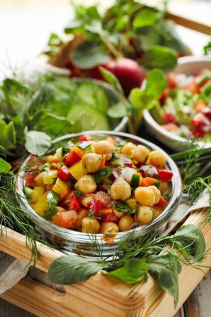 Photo for Fresh vegetarian salad with chickpeas, chopped peppers, onions, cucumbers, carrots and herbs. Healthy and nutrition diet - Royalty Free Image