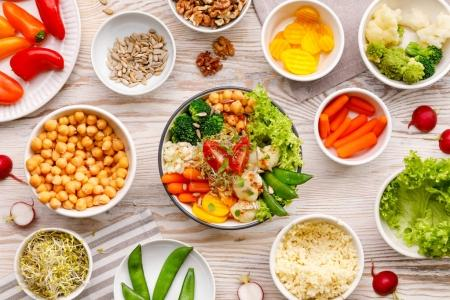 Photo for Buddha bowl, healthy and balanced vegan meal, fresh salad with a variety of vegetables, healthy eating concept. Top view - Royalty Free Image