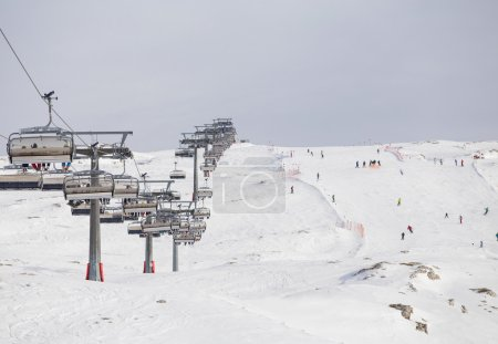 Ski lifts in ski resort going up and down