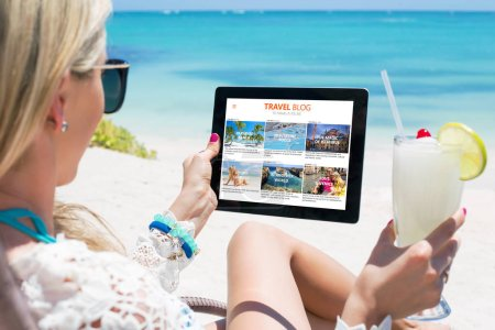 Woman reading travel blog on tablet