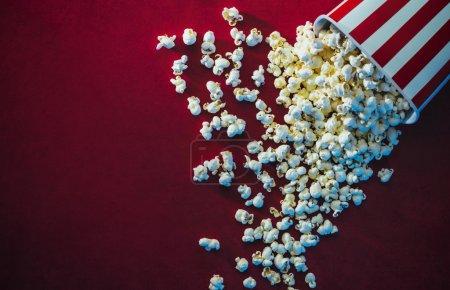 Spilled popcorn on a red background, cinema, movie...