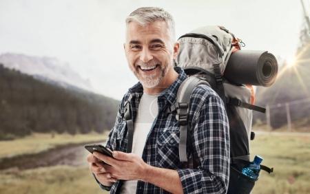 Hiker using a smartphone