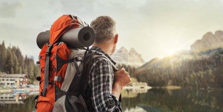 Hiker contemplating a beautiful panorama