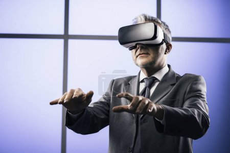 Businessman interacting with virtual reality