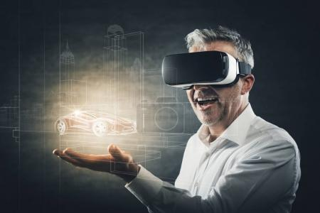 Photo for Cheerful man wearing a VR viewer and experiencing virtual reality, he is holding a virtual object in his hand - Royalty Free Image