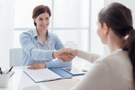 Businesswoman giving an handshake