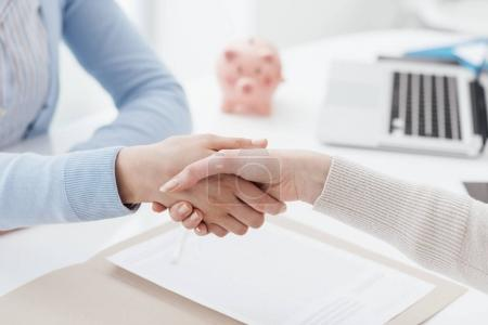 Photo for Financial advisor and customer meeting in the office and shaking hands, agreement and financial planning concept - Royalty Free Image