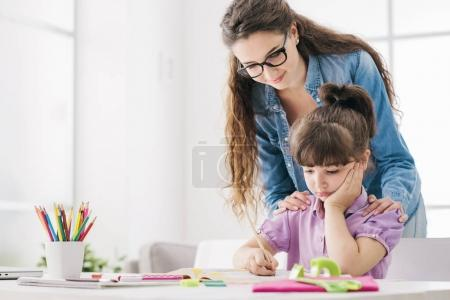 Mother and child doing homework together