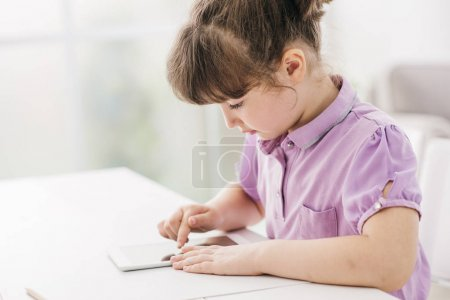 Cute girl using a digital tablet