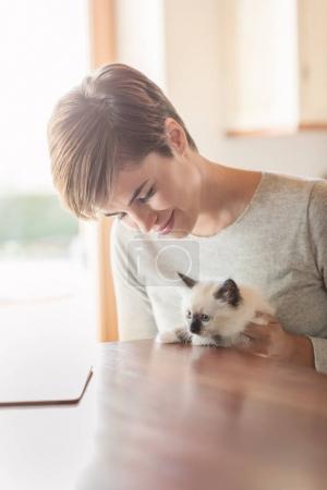 Woman holding her kitten