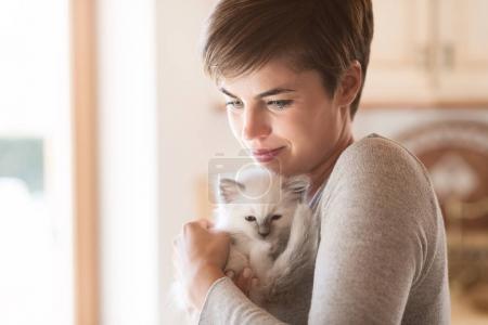 Woman hugging her kitten